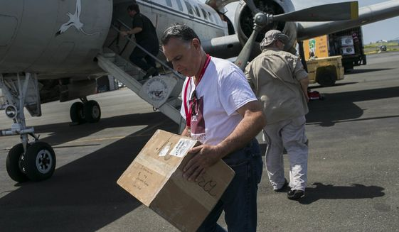 While medical donations are arriving in San Juan, Puerto Rico's pharmaceutical manufacturing plants are struggling in the aftermath of Hurricane Maria. (Associated Press/File)