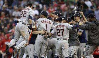 The Houston Astros celebrate their 5-4 win over the Boston Red Sox in Game 4 of baseball's American League Division Series, Monday, Oct. 9, 2017, in Boston. (AP Photo/Charles Krupa) **FILE**