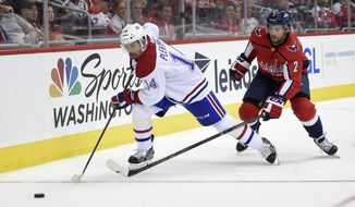 Montreal Canadiens center Tomas Plekanec (14) chases the puck against Washington Capitals defenseman Matt Niskanen (2) during the second period of a NHL hockey game, Saturday, Oct. 7, 2017, in Washington. (AP Photo/Nick Wass)