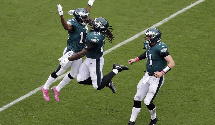 Philadelphia Eagles' Nelson Agholor, from left, LeGarrette Blount and Carson Wentz celebrate after Agholor's touchdown during the second half of an NFL football game against the Arizona Cardinals, Sunday, Oct. 8, 2017, in Philadelphia. (AP Photo/Michael Perez)
