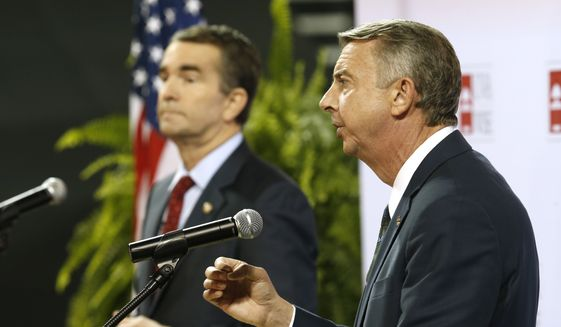 Republican gubernatorial candidate Ed Gillespie, right, gestures during a debate with Democratic challenger Ralph Northam, left, during a debate at University of Virginia-Wise in Wise, Va., Monday, Oct. 9, 2017. (AP Photo/Steve Helber)