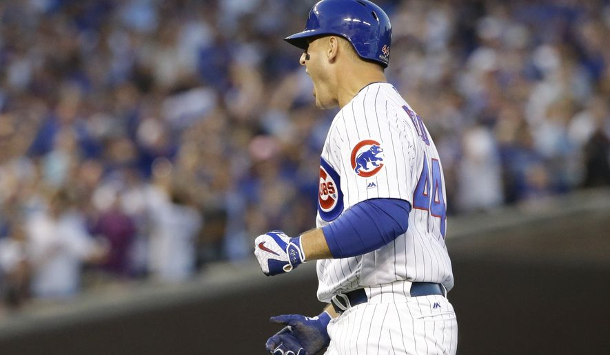 Chicago Cubs' Anthony Rizzo reacts after hitting an RBI single during the eighth inning of Game 3 of the National League Division Series baseball game against the Washington Nationals Monday, Oct. 9, 2017, in Chicago. (AP Photo/Nam Y. Huh)