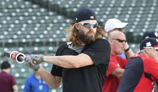 Washington Nationals left fielder Jayson Werth (28) waits to take batting practice at Wrigley Field, Sunday, Oct. 8, 2017, in Chicago. Baseball's Game 3 of the National League Division Series between the Nationals and the Chicago Cubs is Monday. (AP Photo/David Banks)