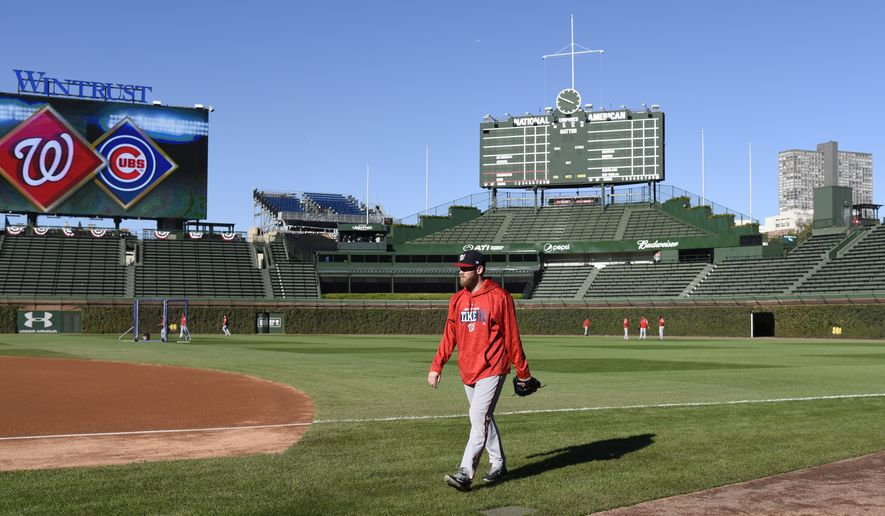 Washington Nationals ace Stephen Strasburg (37) walks on the field during practice at Wrigley Field, Sunday, Oct. 8, 2017, in Chicago. (AP Photo/David Banks)