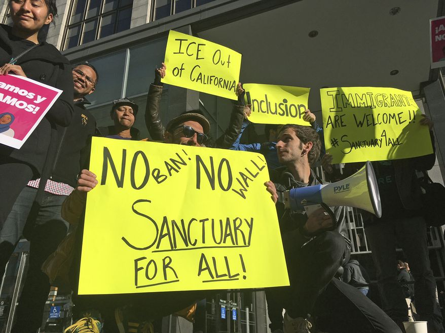 Some jurisdictions say the Trump administration is trying to bully them into dropping their protections for illegal immigrants. (Associated Press/File)