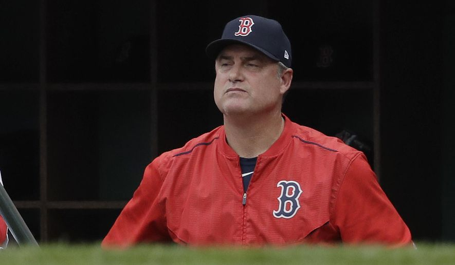 Boston Red Sox manager John Farrell watches from the dugout during the second inning in Game 3 of baseball's American League Division Series against the Houston Astros, Sunday, Oct. 8, 2017, in Boston. (AP Photo/Charles Krupa)