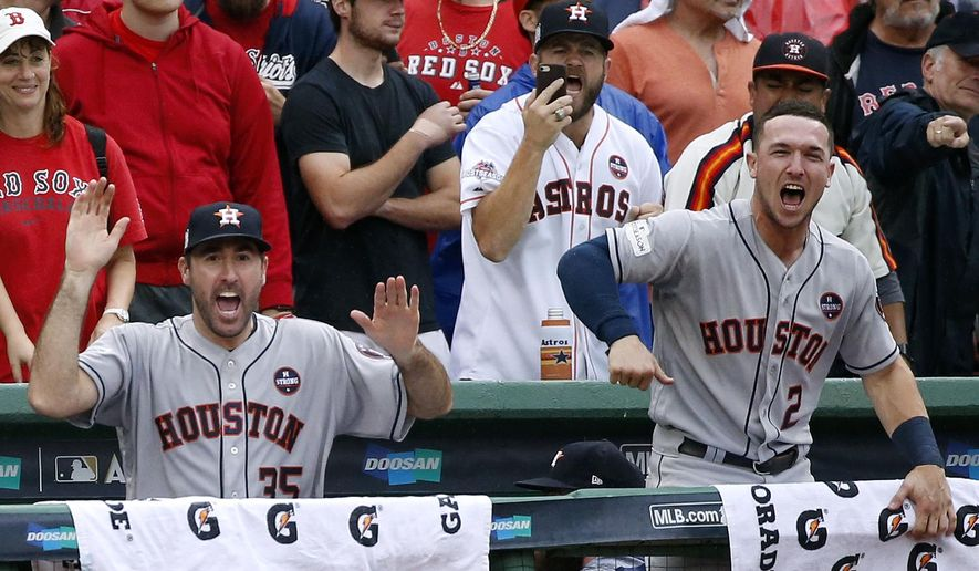 Houston Astros relief pitcher Justin Verlander, left, and Houston Astros third baseman Alex Bregman, right, cheer after Josh Reddick hit an RBI single in the eighth inning in Game 4 of baseball's American League Division Series against the Boston Red Sox, Monday, Oct. 9, 2017, in Boston. (AP Photo/Michael Dwyer)