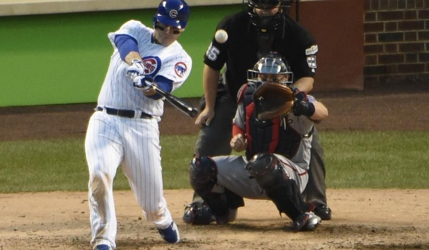 Chicago Cubs' Anthony Rizzo hits an RBI single during the eighth inning of Game 3 of the National League Division Series baseball game against the Washington Nationals Monday, Oct. 9, 2017, in Chicago. (AP Photo/David Banks)