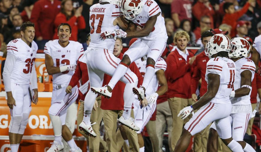 Wisconsin running back Garrett Groshek (37) celebrates with cornerback Derrick Tindal (25) after Tindal stripped the ball from Nebraska wide receiver Stanley Morgan Jr. (8), for a turnover recovered by Wisconsin linebacker Ryan Connelly, unseen, during the second half of an NCAA college football game in Lincoln, Neb., Saturday, Oct. 7, 2017. Wisconsin won 38-17. (AP Photo/Nati Harnik)