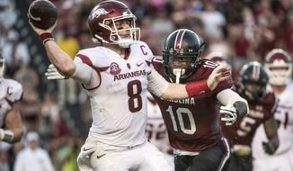 Arkansas quarterback Austin Allen (8) attempts a pass against South Carolina linebacker Skai Moore (10) during the second half of an NCAA college football game Saturday, Oct. 7, 2017, in Columbia, S.C. (AP Photo/Sean Rayford)