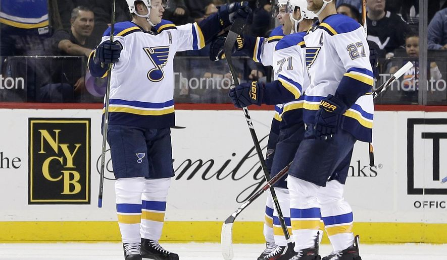 St. Louis Blues' Vladimir Tarasenko, left, reacts after scoring a goal during the second period of an NHL hockey game against the New York Islanders, Monday, Oct. 9, 2017, in New York. (AP Photo/Seth Wenig)