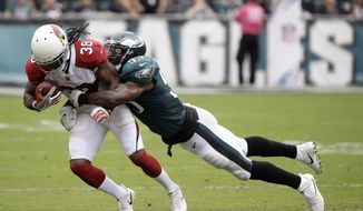 Arizona Cardinals' Andre Ellington, left, is tackled by Philadelphia Eagles' Nigel Bradham during the second half of an NFL football game, Sunday, Oct. 8, 2017, in Philadelphia. (AP Photo/Matt Rourke)