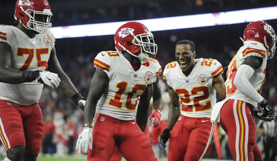 Kansas City Chiefs' Tyreek Hill (10) celebrates his touchdown with teammates during the second half of an NFL football game against the Houston Texans, Sunday, Oct. 8, 2017, in Houston. (AP Photo/Eric Christian Smith)