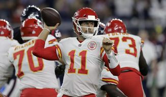 Kansas City Chiefs quarterback Alex Smith (11) throws against the Houston Texans during an NFL football game, Sunday, Oct. 8, 2017, in Houston. (AP Photo/David J. Phillip)