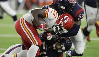 Kansas City Chiefs running back Kareem Hunt (27) is hit by Houston Texans free safety Andre Hal (29) during the first half of an NFL football game Sunday, Oct. 8, 2017, in Houston. (AP Photo/David J. Phillip)
