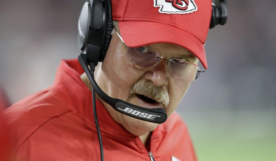 Kansas City Chiefs head coach Andy Reid talks to players on the sideline during the second half of an NFL football game against the Houston Texans, Sunday, Oct. 8, 2017, in Houston. (AP Photo/David J. Phillip)