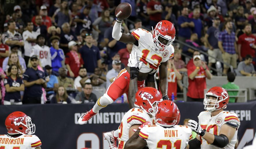 Kansas City Chiefs wide receiver De'Anthony Thomas (13) celebrates his touchdown with teammates during the second half of an NFL football game against the Houston Texans, Sunday, Oct. 8, 2017, in Houston. (AP Photo/David J. Phillip)