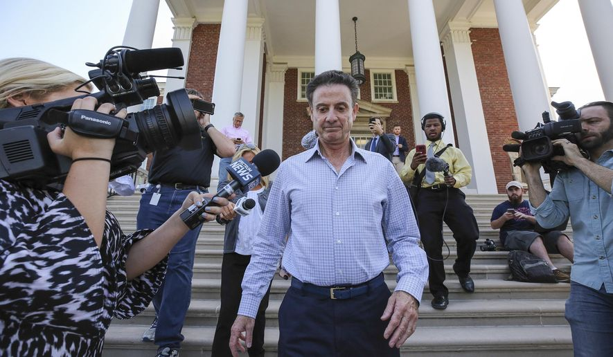 FILE - In this Wednesday, Sept. 27, 2017, file photo, Louisville men's basketball coach Rick Pitino leaves Grawemeyer Hall after having a meeting with the university's interim president Greg Postel in Louisville. Ky. A federal probe illuminates a shady side of college basketball recruiting filled with bribes and kickbacks. The probe also implicated Louisville for paying a player to attend the school, leading to Pitino and athletic director Tom Jurich to be placed on administrative leave. (Michael Clevenger/The Courier-Journal via AP, File)