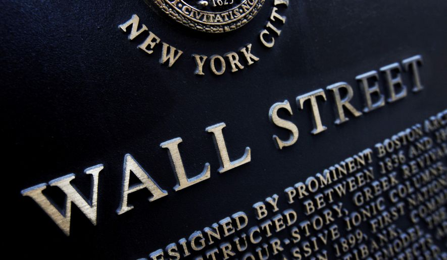 FILE - This Jan. 4, 2010, file photo shows an historic marker on Wall Street in New York. U.S. stocks are mixed early Monday, Oct. 9, 2017, as technology companies rise ahead of another round of company earnings later in the week. (AP Photo/Mark Lennihan, File)
