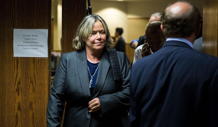 Dr. Eden Wells, chief medical executive of the Michigan Department of Health and Human Services, appears in court for the first day of her preliminary examination on Monday, Oct. 9, 2017, in District Court in Flint, Mich. The hearing was postponed when prosecutors said they would add a charge of involuntary manslaughter. (Terray Sylvester/The Flint Journal-MLive.com via AP)