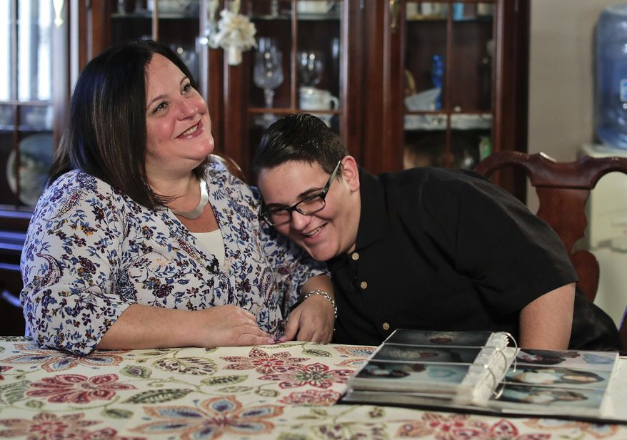 In this Monday, Oct. 2, 2017, photo, Beth Guardino, left, and her son, Christian, talk about the 17-year-old's life before and after gene therapy treatment for his hereditary blindness during an interview at their home in Patchogue, N.Y. Christian was diagnosed with hereditary blindness and received gene therapy as part of a study. On Thursday, Oct. 12, U.S. Food and Drug Administration advisers will consider whether to recommend approval of the gene therapy. (AP Photo/Julie Jacobson)