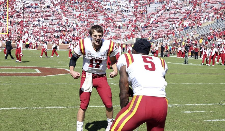 Iowa State quarterback Kyle Kempt (17) celebrates with defensive back Kamari Cotton-Moya (5) after an NCAA college football game against Oklahoma in Norman, Okla., Saturday, Oct. 7, 2017. Iowa State defeated No. 3 Oklahoma 38-31. (Ian Maule/Tulsa World via AP)
