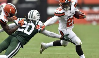 Cleveland Browns running back Duke Johnson (29) avoids a tackle by New York Jets cornerback Marcus Williams (20) as he scores a 41-yard touchdown during the second half of an NFL football game, Sunday, Oct. 8, 2017, in Cleveland. (AP Photo/David Richard)