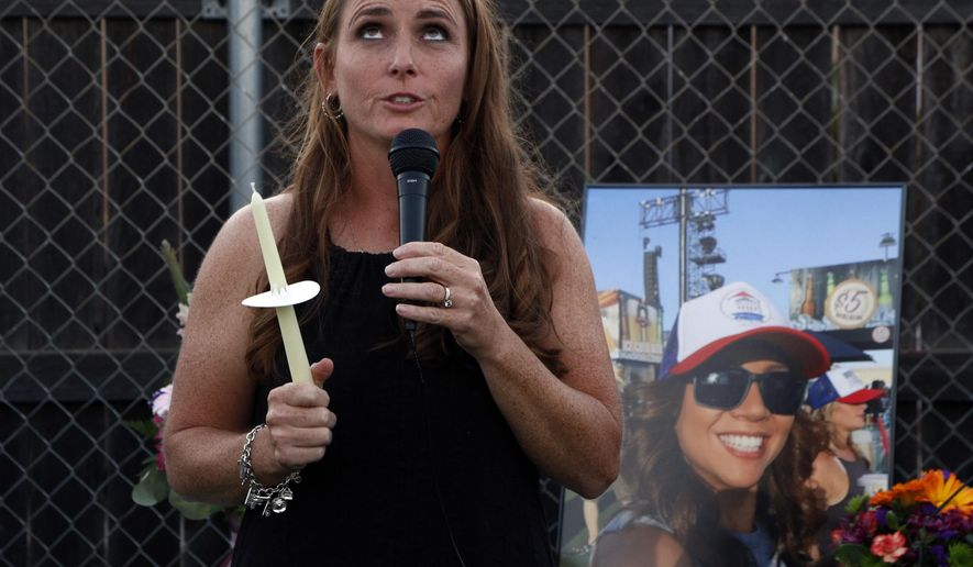 Courtney Calderon, a friend of Nicol Kimura, a victim of the Las Vegas mass shooting, speaks during a vigil at Sierra Vista Elementary School in Placentia, Calif., Sunday, Oct. 8, 2017. (AP Photo/Reed Saxon)