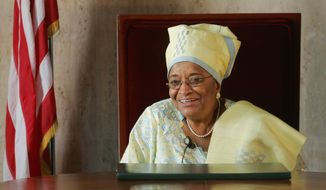 FILE- In this Jan. 20, 2006 photo, Liberian President Ellen Johnson Sirleaf speaks to journalists at the Executive Mansion in Monrovia, Liberia. Liberia heads to the polls Tuesday Oct. 10, 2017 for elections that for the first time in more than 70 years will see one democratically elected government hand power to another as Sirleaf, a Nobel Prize-winning leader, steps aside. (AP Photo/Jerome Delay, file)