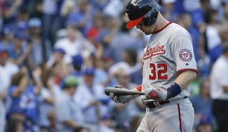 Washington Nationals' Matt Wieters looks down after striking out during the second inning of Game 3 of the National League Division Series baseball game =a=Monday, Oct. 9, 2017, in Chicago. (AP Photo/Nam Y. Huh)