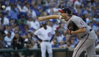 Washington Nationals starting pitcher Max Scherzer throws during the first inning of Game 3 of the National League Division Series baseball game against the Chicago Cubs Monday, Oct. 9, 2017, in Chicago. (AP Photo/Nam Y. Huh)