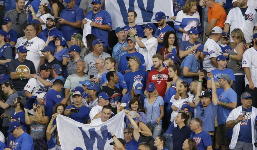 Fans celebrate after Game 3 of the National League Division Series baseball game against the Washington Nationals Monday, Oct. 9, 2017, in Chicago. The Cubs won 2-1 to take a 2-1 lead in the series. (AP Photo/Nam Y. Huh)