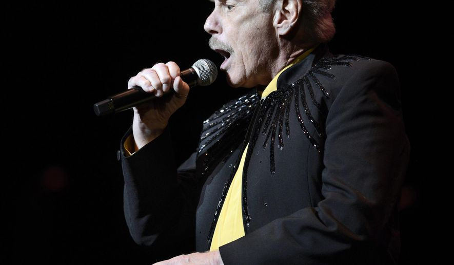 """In this April 4, 2015 photo, Skyliners lead singer Jimmy Beaumont performs at Pittsburgh Rockin' Reunion at the Benedum Center in Pittsburgh. The lead singer of the doo-wop group, who co-wrote the iconic ballad """"Since I Don't Have You,"""" has died. Beaumont was 76. Beaumont's family says he died in his sleep Saturday, Oct. 7, 2017, at his home in McKeesport, Pa. (Bill Wade/Pittsburgh Post-Gazette via AP)"""