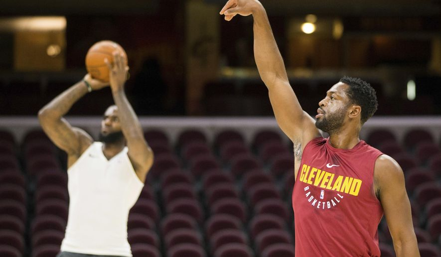 Cleveland Cavaliers' Dwyane Wade, right, watches his shot as LeBron James takes a shot during warmups before an NBA preseason basketball game against the Indiana Pacers, Friday, Oct. 6, 2017, in Cleveland. (AP Photo/Scott R. Galvin)