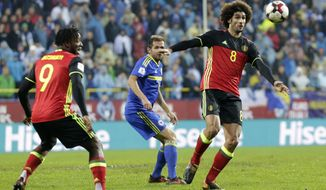 Bosnia's Senad Lulic, center, challenges Belgium's Marouane Fellaini, right, during the World Cup Group H qualifying soccer match between Bosnia and Belgium at the Grbavica stadium in Sarajevo, Bosnia, Saturday, Oct. 7, 2017. (AP Photo/Amel Emric)