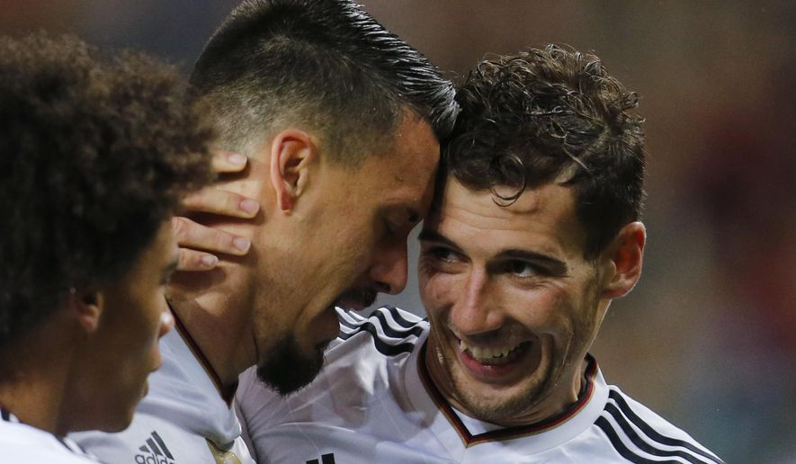 Germany's Sandro Wagner, left, and his teammate Leon Goretzka celebrate after Wagner scored his side's second goal during the 2018 World Cup qualifying Group C soccer match between Germany and Azerbaijan in Kaiserslautern, Germany, Sunday, Oct. 8, 2017.(AP Photo/Michael Probst)