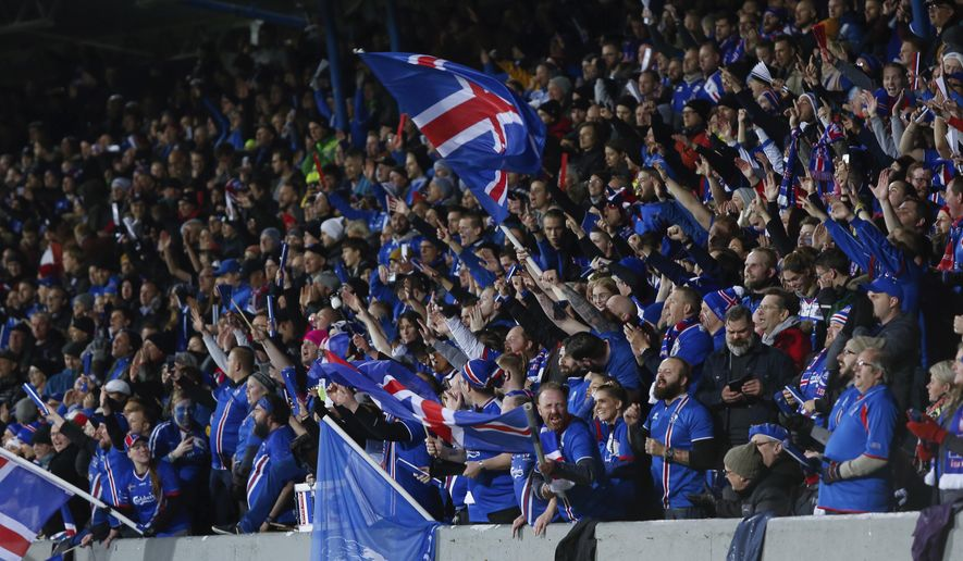 Iceland's fans celebrate after their team scored against Kosovo, during the World Cup Group I qualifying soccer match between Iceland and Kosovo in Reykjavik, Iceland, Monday Oct. 9, 2017. (AP Photo/Brynjar Gunnarsson).