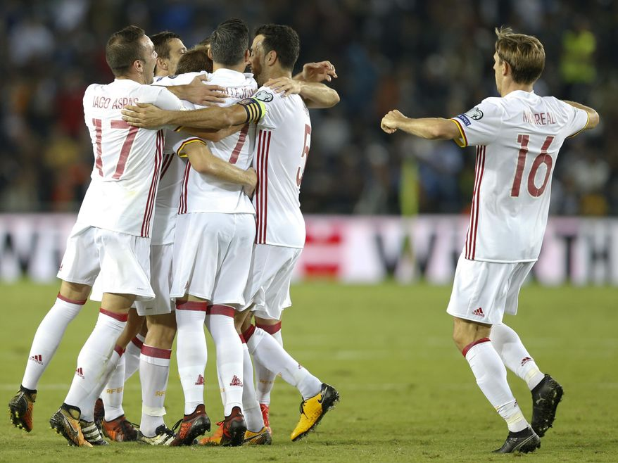 Spanish players celebrate after they scored against Israel during the World Cup Group G match in Jerusalem, Monday, Oct.9, 2017. (AP Photo/Ariel Schalit)