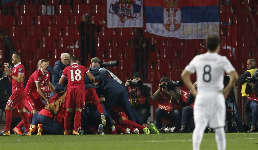 Serbia's Aleksandar Prijovic celebrates with his teammates after scoring a goal, during the World Cup Group D qualifying soccer match between Serbia and Georgia at the Rajko Mitic stadium in Belgrade, Serbia, Monday, Oct. 9, 2017. (AP Photo/Darko Vojinovic)