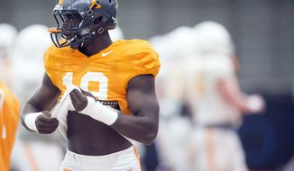 "FILE - In this April 7, 2016, file photo, Tennessee defensive lineman Darrell Taylor (19) attends NCAA college football practice in Knoxville, Tenn. Tennessee has suspended starting defensive end Darrell Taylor indefinitely, the latest adversity for a team that has dropped its first two Southeastern Conference games and is coming off its most lopsided home loss since 1905. Volunteers coach Butch Jones said Monday, Oct. 9, 2017, that ""multiple factors"" had led to Taylor's suspension. (Saul Young/Knoxville News Sentinel via AP, File)"