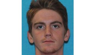 This undated photo provided by Texas Tech University shows Hollis Daniels. A Texas Tech University police officer has been shot and killed at the campus police headquarters, prompting a lockdown of the campus on Monday, Oct. 9, 2017. University spokesman Chris Cook says campus police brought Daniels, suspected of drug violations to police headquarters on Monday. The suspect pulled a gun and shot an officer in the head, killing him and then fled on foot and has not been captured, according to Cook. (Texas Tech University via AP)