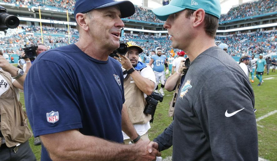 Tennessee Titans head coach Mike Mularkey, left, shakes the hand of Miami Dolphins head coach Adam Gase, at the end of an NFL football game, Sunday, Oct. 8, 2017, in Miami Gardens, Fla. The Dolphins defeated the Titans 16-10. (AP Photo/Wilfredo Lee)
