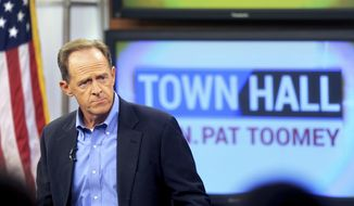 In this Aug. 31, 2017, file photo, Sen. Pat Toomey holds a town-hall meeting at the WLVT/PBS 39-TV studios in Bethlehem, Pa. (Tom Gralish/The Philadelphia Inquirer via AP, File)