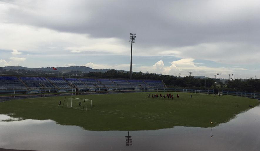 Water surrounds the field during U.S. national soccer team training in Couva, Trinidad, Monday, Oct. 9, 2017. Team USA plays against Trinidad & Tobago on Tuesday. (AP Photo/Ron Blum)