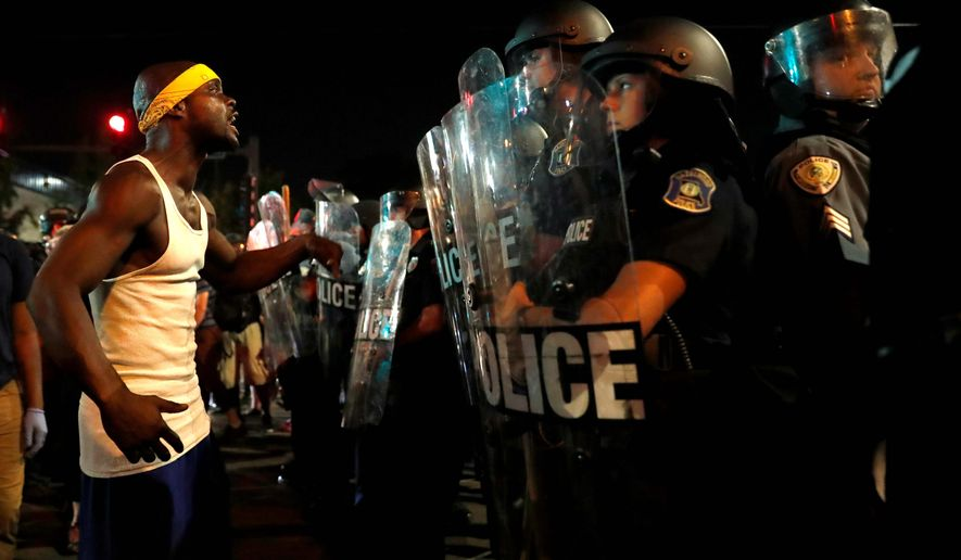 "The executive director of the Missouri ACLU said that ""there are unfortunately ongoing, multiple instances of arbitrary unconstitutional acts by police"" against St. Louis protesters who have taken to the streets in order to decry police brutality. (Associated Press)"