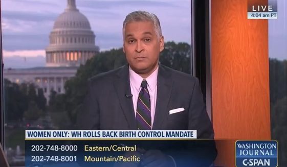 """C-SPAN host Pedro Echevarria listens intently to a caller on""""Washington Journal."""" C-SPAN marks 20th anniversary on the radio this week. (C-Span)"""