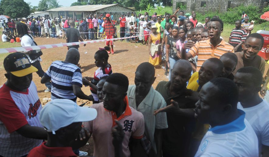 Liberians gathered in masses under the sun Tuesday to vote in an election that, for the first time in more than 70 years, will see one democratically elected government hand power to another, as Africa's first female president prepares to step aside. (Associated Press photographs)