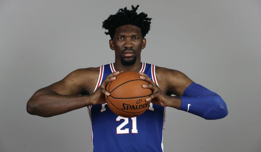 FILE - In this Sept. 25, 2017, file photo, Philadelphia 76ers' Joel Embiid poses for a photograph during media day at the NBA basketball team's practice facility, in Camden, N.J. Philadelphia bet its future on Embiid, signing one of the more talented, yet injury-prone, players in the game to a league maximum contract extension. A person familiar with the situation tells The Associated Press that Embiid and the Sixers have agreed on a $148 million, five-year extension and it could increase even more if the 7-foot center reaches certain incentives. The person spoke on condition of anonymity Monday, Oct. 9, 2017, because the contract has not been officially announced.(AP Photo/Matt Rourke, File)