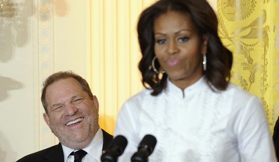 """First lady Michelle Obama hosted Harvey Weinstein at the White House in 2013 for a workshop for students interested in the film industry. """"I want to start by thanking Harvey Weinstein for organizing this amazing day,"""" Mrs. Obama said at the time. """"This is possible because of Harvey. He is a wonderful human being, a good friend and just a powerhouse."""" (Associated Press)"""