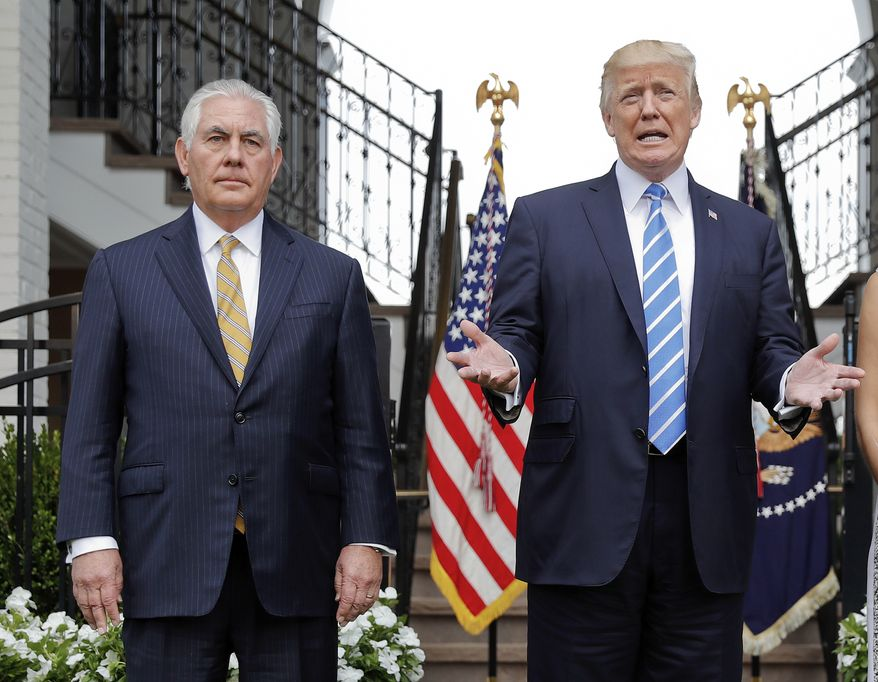 President Donald Trump with Secretary of State Rex Tillerson, left, speaking to members of the media following their meeting at Trump National Golf Club in Bedminster, N.J., Friday, Aug. 11, 2017. (AP Photo/Pablo Martinez Monsivais)